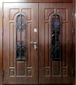 двери в дом мдф с ковкой