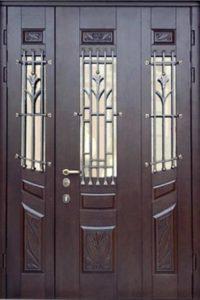 двери двухстворчатые ковҡой под заказ
